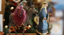 In this figurine, Joseph leads the donkey carrying Mary on their journey to Bethlehem. Photo by Kathleen Barry, United Methodist Communications.