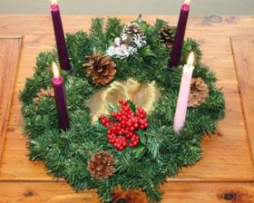 Many families decorate their home before Christmas with an Advent wreath, which holds four candles signifying the four Sundays of Advent. Photo by Jonathunder, courtesy Wikimedia Commons