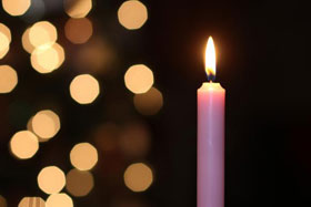 The third Sunday in Advent sees the lighting of the pink or rose candle. Photo by Kathleen Barry, United Methodist Communications.