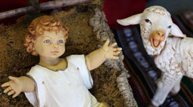 Baby Jesus and lamb figurine from Nativity scene. Photo by Kathleen Barry, United Methodist Communications.