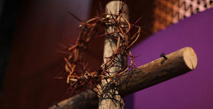 A Lenten display- crown of thorns and cross with purple cloth herald the beginning of Lent. Photo by Kathleen Barry, United Methodist Communications.