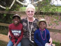 Kay 'Bibi Kay' Oursler sits with two children who live at Sunrise Children's Home in Tanzania, the orphanage Oursler founded.