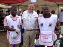 Scott Gilpin (center) stands with Red Cross workers with whom he volunteered in the days following the Westgate Mall massacre in Kenya.