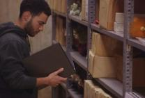 A student works in the vault at the United Methodist General Commission on Archives and History, based at Drew University in New Jersey. Video image by United Methodist Communications.