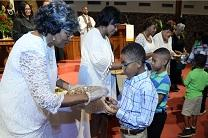 Children take communion in a United Methodist church. Courtesy United Methodist Communications.