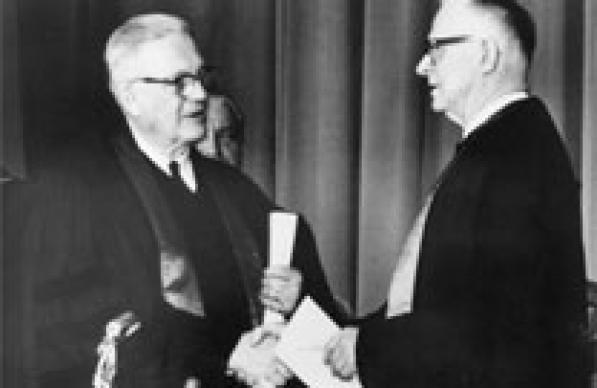 Evangelical United Brethren Church Bishop Reuben H. Mueller (left) and Methodist Bishop Lloyd C. Wicke join hands on April 23, 1968. Photo courtesy of archives of United Methodist Communications.