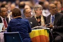 Delegates listen and prepare to vote from the floor Feb. 25 during the 2019 United Methodist General Conference inside the Dome at America's Center in St. Louis.