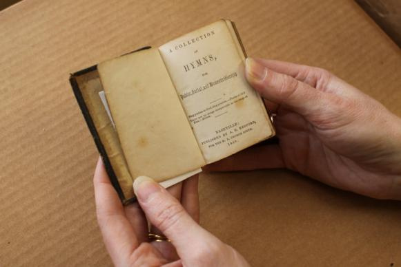 This 19th century hymnal was very small in order to fit in a pocket. Courtesy of the General Commission on Archives and History of The United Methodist Church. Photo by Kathleen Barry, United Methodist Communications.