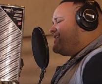 Jeremy Rosado records tracks for a new song dedicated to United Methodists and the fight against malaria. Video image courtesy of United Methodist Communications.