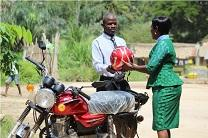 The Rev. Cecelia Marpleh, district superintendent for the Liberia Conference, presents a motorbike to Pastor William Kulah for his travels to Gbanjuloma United Methodist Church each week. With the motorbike, it takes him five hours to get to his assigned church.