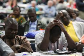 Delegates pray at General Conference 2016