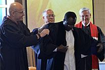 The Rev. Botrous Tutu, a newly licensed local pastor, receives his clergy robe from (left to right) Rev. John Gargis, Rev. Michael Sluder, and Rev. Charles Maynard during a June 11 ceremony. Photo courtesy of the Holston Conference of The United Methodist Church.