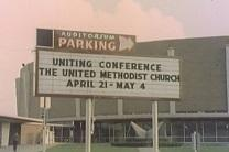 Image from film shows the marquee outside the Dallas Convention Center during the 1968 Uniting Conference.