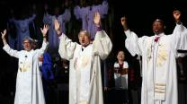 Bishops Hope Morgan Ward (left), Hee-Soo Jung, and John Yambasu shout,