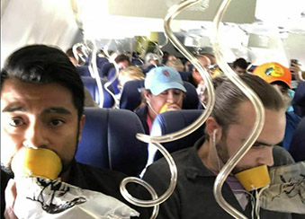 Pictures taken during an incident on Southwest Flight 1380 revealed that most of the passengers did not put their oxygen masks on correctly. They were placing the masks over just their mouth, not their mouth and nose, as they were instructed to do. Photo from @BobbyLaurie, Twitter.