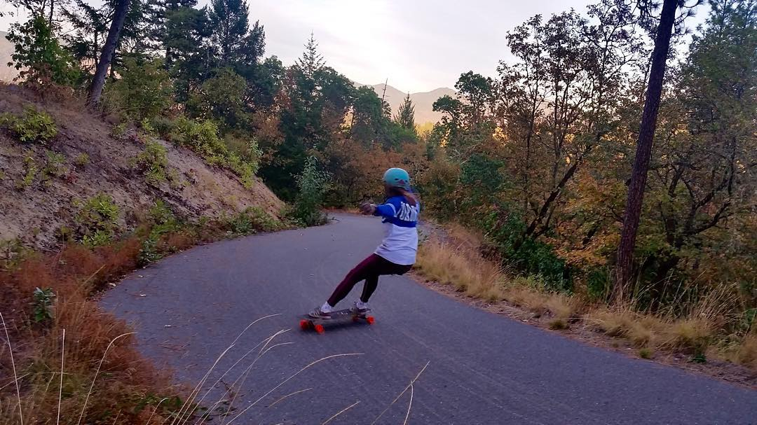 Team rider @iamcindyzhou enjoys some fall foliage and powerslides on a closed road in Medford, #Oregon!