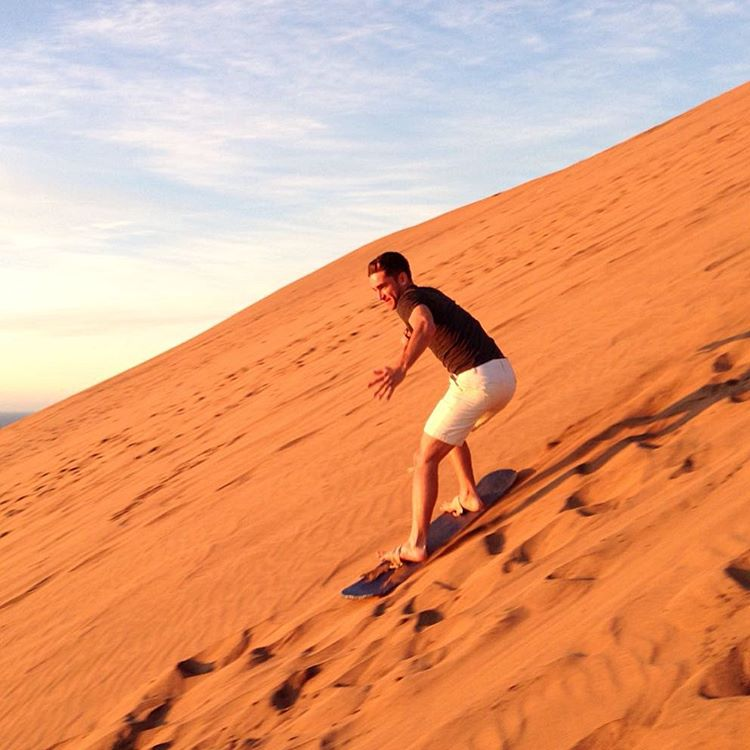 #sandboarding with jazz hands next to the Pacific at sunset. What could be better?