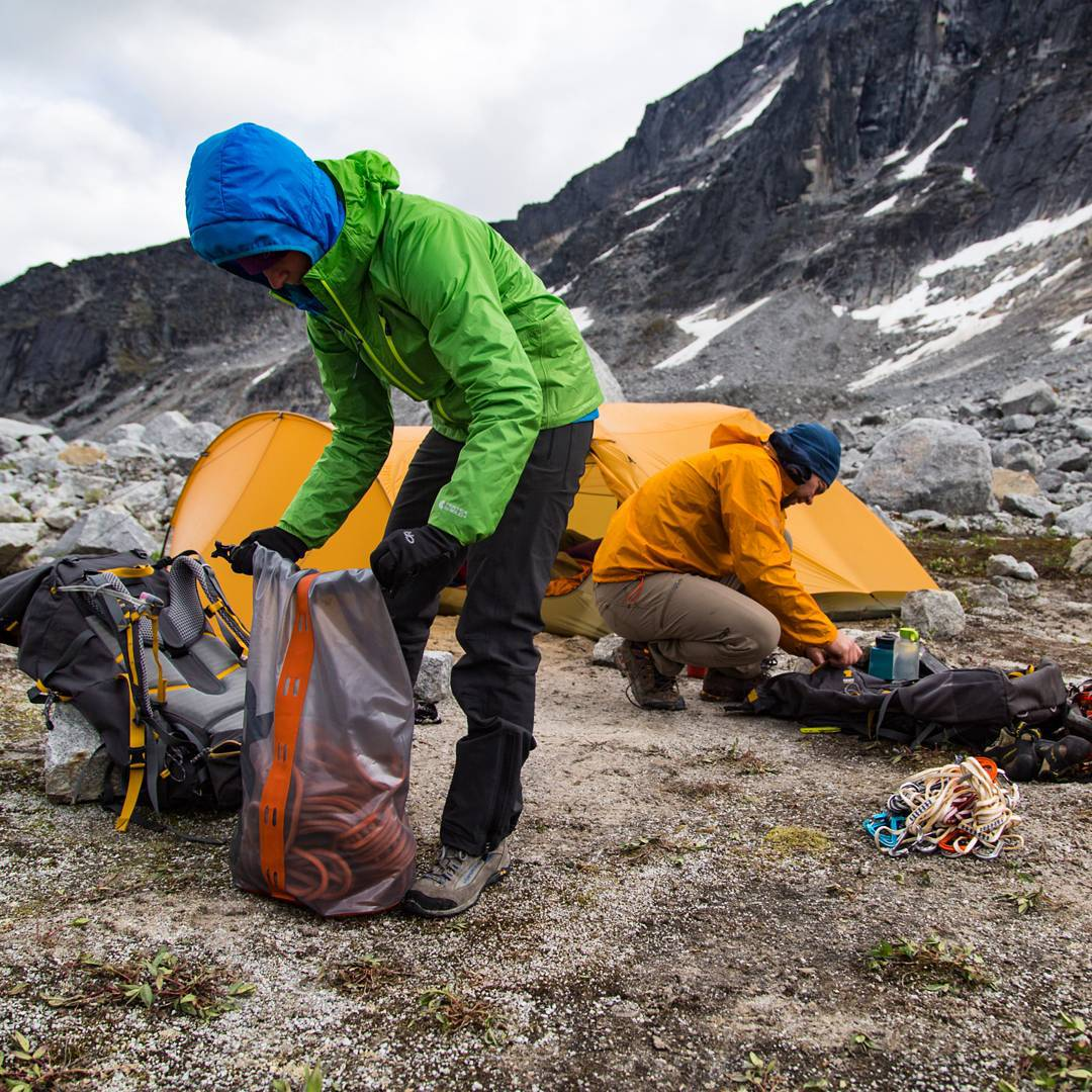 VAMPIRE SPIRES 2: Canadian Climbing Expedition Tip: Bring LOTS of dry bags. Pat Goodman and I gearing up at advanced base camp to get in position to pounce at the next break in the weather.  Photo: @jamesqmartin Words: @jessagoebel  #getoutstayout