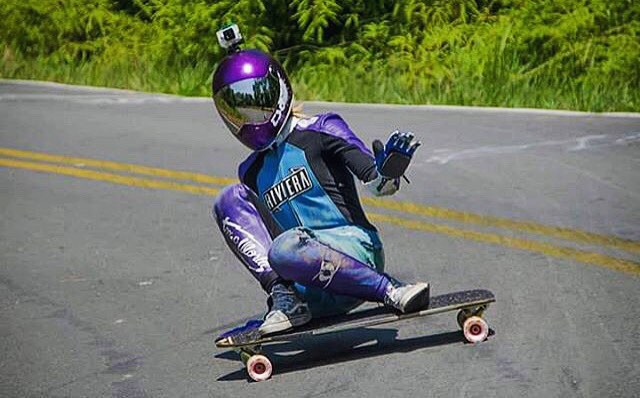 Sending good vibes and stylish slides, @palaxa waves as she rides by at 7 Curves in Brazil.