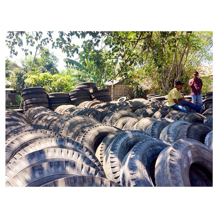 We asked these men what becomes of the tires. 50% goes towards recycling to make car interiors, crafts, etc. The other 50%? Take a guess in the comments below.