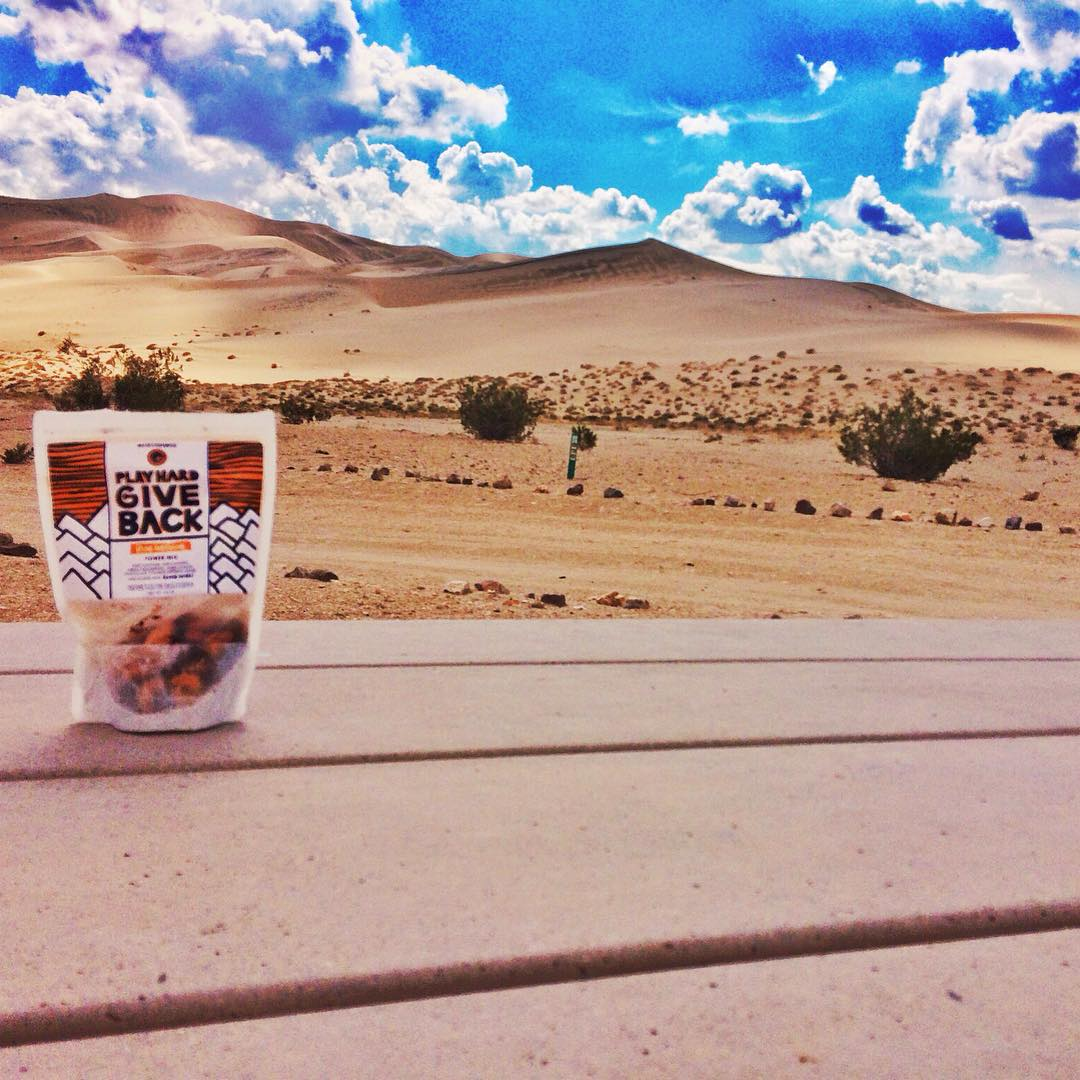 Snacking on some phgb #trailmix in #deathvalley! Where do you stay fueled with our tasty #snacks?! #snackwithpurpose #exploremore #getoutside #california #nationalpark