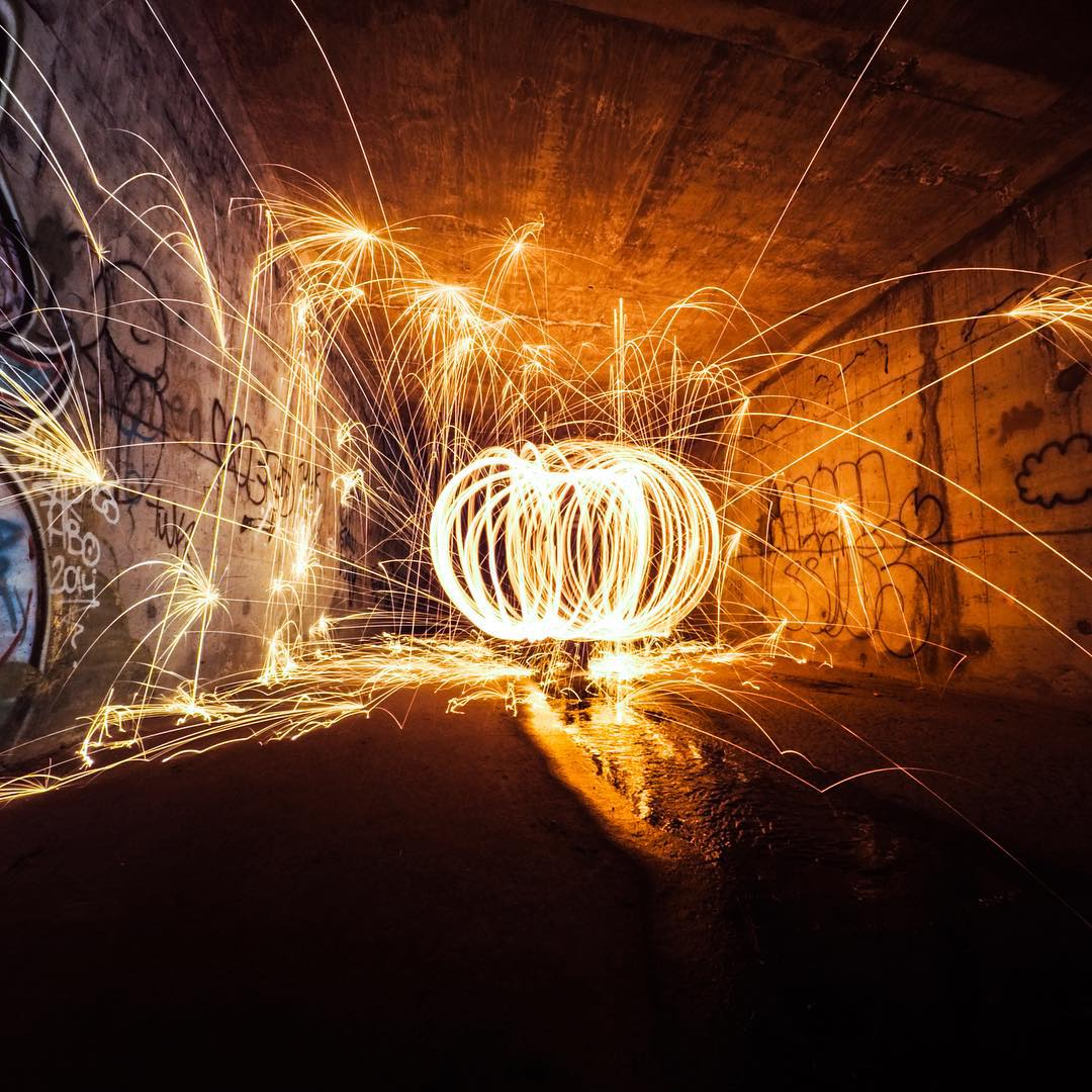 GoPro Featured Photographer - @night.crawlers  About the Shot: Pumpkin Steel Wool - We do lots of photos in this tunnel near our home, not only because its pitch black inside, but because there is a lot of cool #graffiti inside that adds a cool aspect...