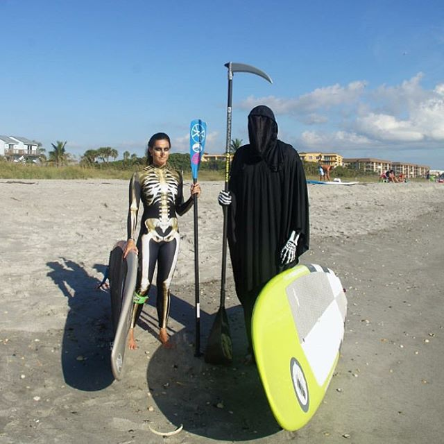 Surf Zombie @waveofwellness and Grim Reaper @dontfearthesweeper catching a few waves before tonights festivities...