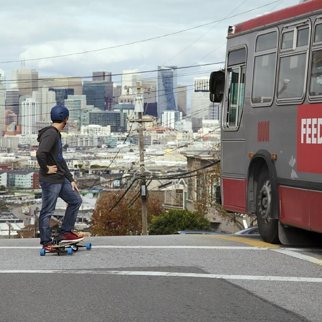 Andrè Vaz getting ready to drop an #SF classic #snowboard the streets  Photo credit- Matt Reyes