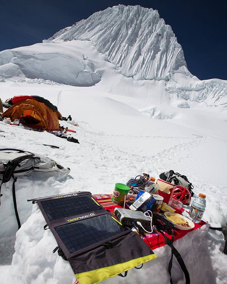 Downtime in basecamp beneath Alpamayo. #getoutstayout  Photo: @smileysproject
