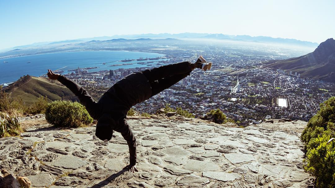 Howzit? We're in #CapeTown for the Red Bull #Amaphiko Academy. Amaphiko gives #wings to people and ideas. Here's #redbullfamily member and #bboy @kreatelamine inspiring the Academy's participants at the top of Lion's Head Mountain on Day 4 of a week of...