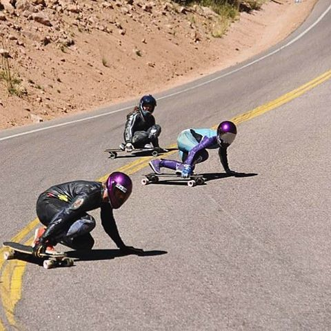 Throwback to teammates @lonniesk8 & @palaxa swooping in on a tight left at the @pikespeakworldcup with @skatebagels close behind. Epic racing on #americasmountain.  #divinewheelco #divinewheels