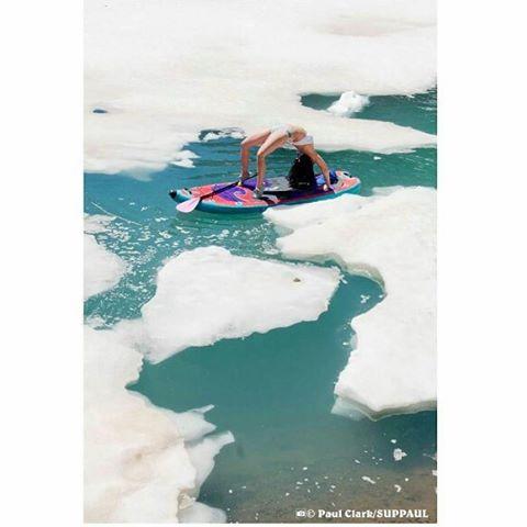 @kashapup doing some yoga with icebergs. Photo: @suppaul_pics #halagear #adventuredesigned #sup #paddleboarding #isup #yoga #supyoga #Namastesup #yogaonsup #yogaeverydamnday #standuppaddle #paddleboardyoga #yogaeverywhere