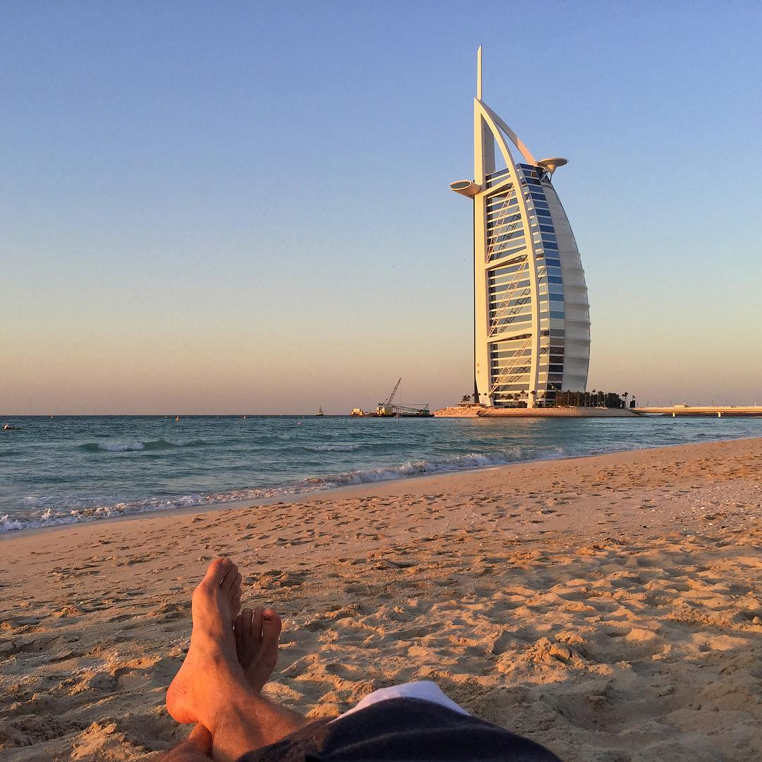 I'm a huge fan of architecture. I'm also a fan of beaches. So yeah, this sunset view of the Burj Al Arab is perfect right now. #exoticbeachvibes #fullsail #comesailaway #beachedasbru #Dubai