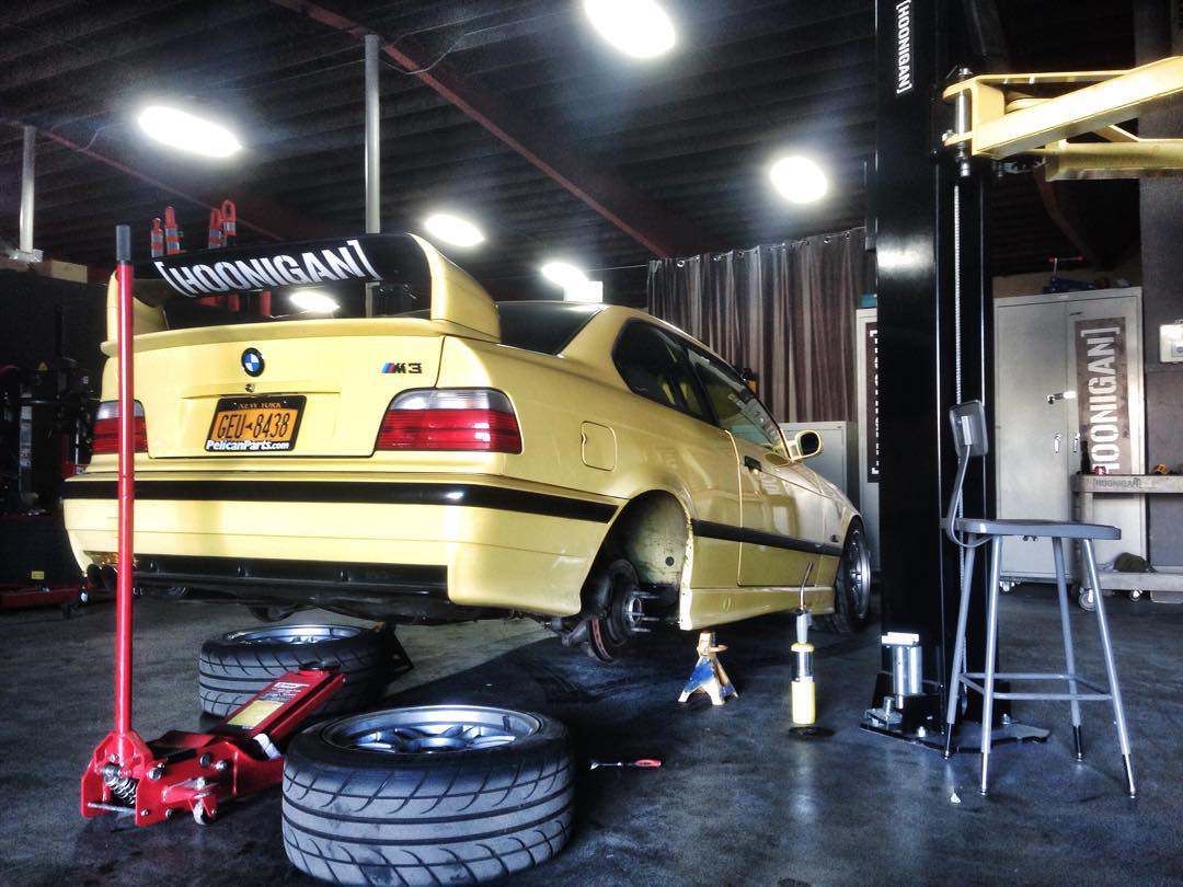 "Early morning suspension adjustments on @vin_tra's e36 m3. Like that 28"" die cut on the wing? Get it on #hooniganDOTcom."