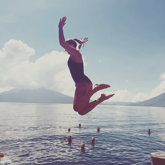 LIFE IS A GREAT ADVENTURE OR NOTHING AT ALL | JUMP IN #Yogini @elizabethkountze taking a leap on retreat in #Guatemala #yogaretreat #yogaleggings #waterwoman #surfleggings #santacruzlalaguna #adventure #traveltuesday #sunset #sunsetscales #OKIINO