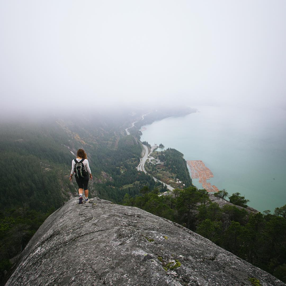 "Into the mist: ""Out for a stroll with @erinoutdoors on the Chief near Squamish, B.C."" - @taylormichaelburk"