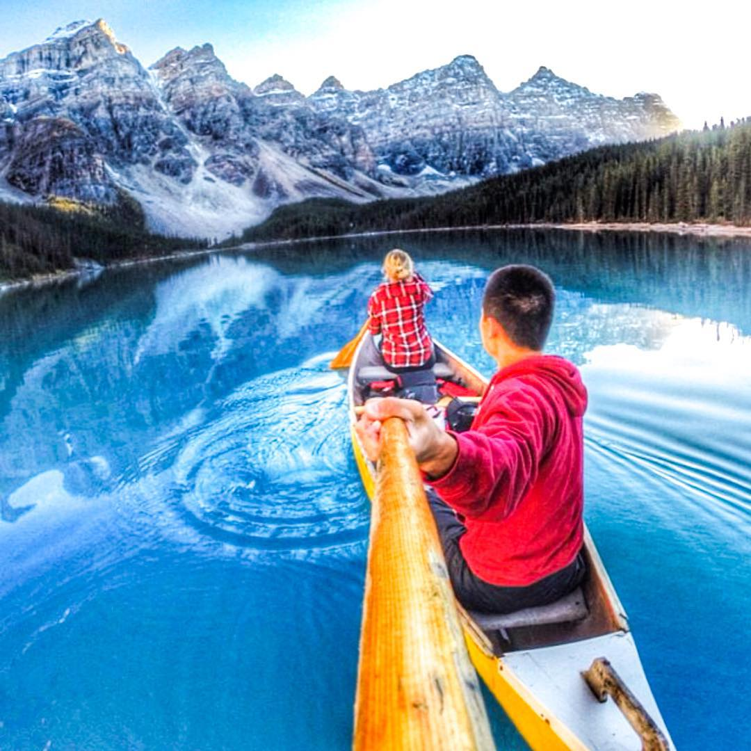 Winter blues and cozy reds  @mattfestejo exploring at Moraine Lake in Alberta, Canada  #Kameleonz #KZWinterLake #Holidays
