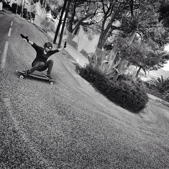 Check out @alex_kubiak_ho_chi rocking a left corner. @laurent_perigault photo #longboardgirlscrew