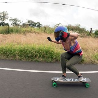 Our girl @outsideone  is back in Hawaii. @mattkienzle photo.  #longboardgirlscrew #womensupportingwomen #skatelikeagirl #LGC #emmadaigle #hawaii