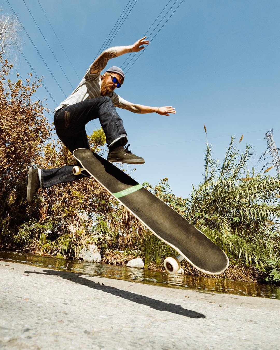 @petermarkgraf with a no comply shov in the LA river. #caliber50 photo @theduster22