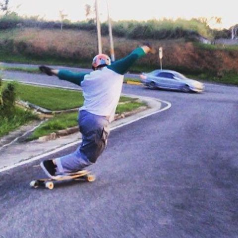 Skate and create flow team rider @pangullvine_96 from Puerto Rico gets artsy with a toeside slide at dusk.  #divinewheelco #divinewheels
