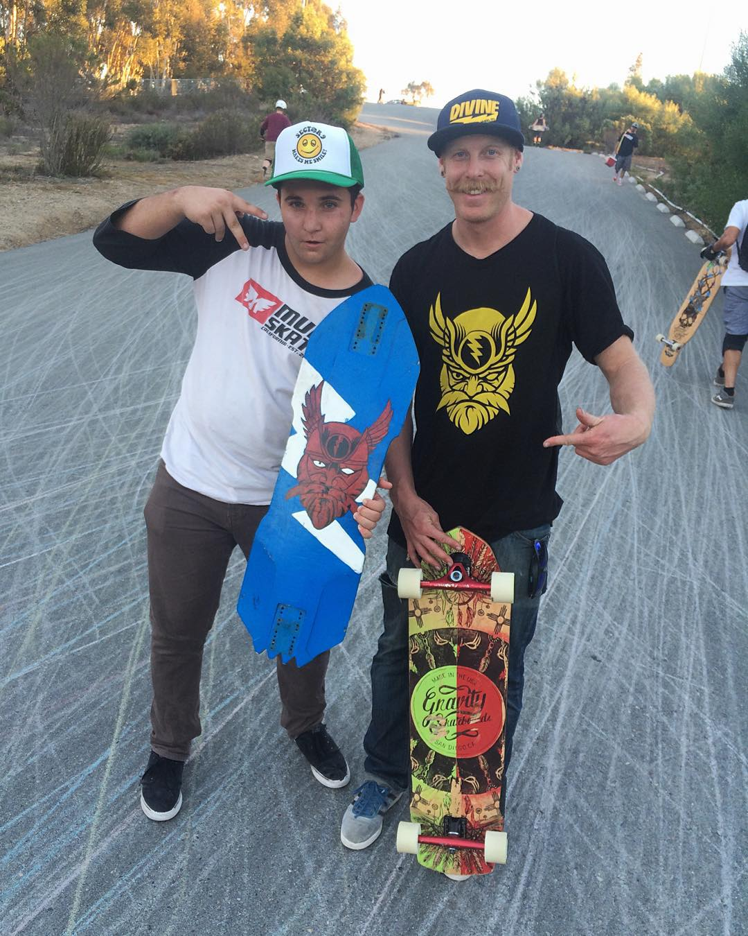 Repping hard! @thee_dictionary has always been a huge supporter of #divinewheelco. Last week he ran into @_ricker_ at the #turkeyslidejam and showed him his hand painted #odin graphic on one of his boards. Standing on a mountain of #thanelines they...
