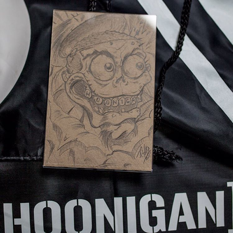 WIN THIS! Surprise surprise! We stuffed this hand draw, one-off piece from our Art Director @jchase7452 into a random grab bag.  There are still a few left so take you chances, it's a sick deal either way! #HooniganBlackFriday  Hoonigan.com (link in bio)