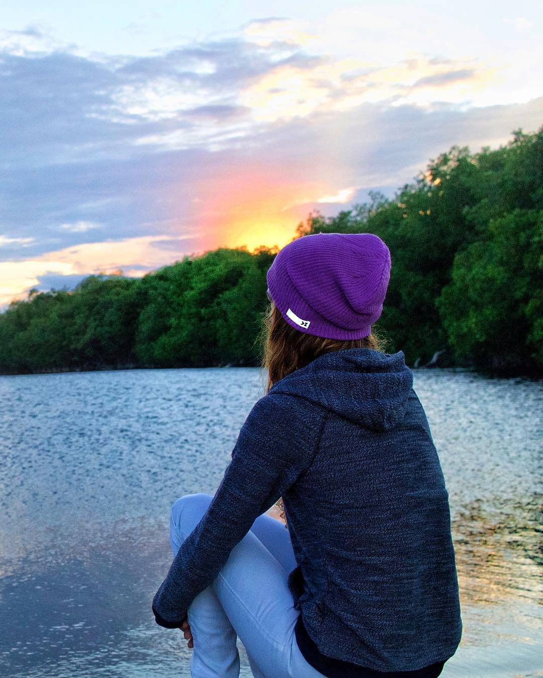 Chilly sunsets by the water CYBER40 = 40% OFF STOREWIDE  Sporting the Lilac beanie while watching the sunset, @amparomaluendez enjoys her night #Kameleonz #Sunset #BeanieSeason #CyberMonday