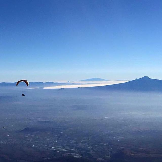 "Argentine @alejoidoyaga paragliding after ascending to the 5250mts high IZTACCIHUATL volcano which means "" mujer dormida "" in NAHUATL . Nice ride!!! #GO #riders #dreamers"
