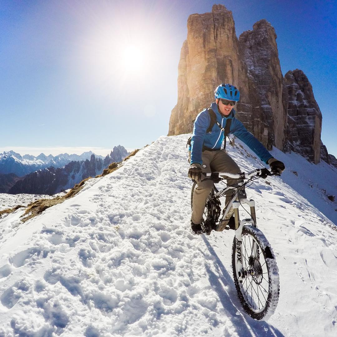 Photo of the Day! While most climb to the famous rock formation of the Tre Cime di Lavaredo, @coberschneider takes it up a notch. Love all things #❄️? Us too! Show us how by following the link in our profile. #GoProSnow #dolomites