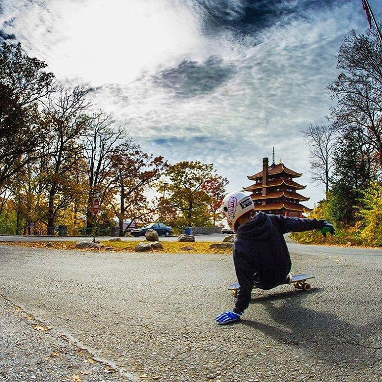 Flying past the pagoda, flow team rider Jake Scarberry (@jake_scarberry) slides in style. Where will you skate today?