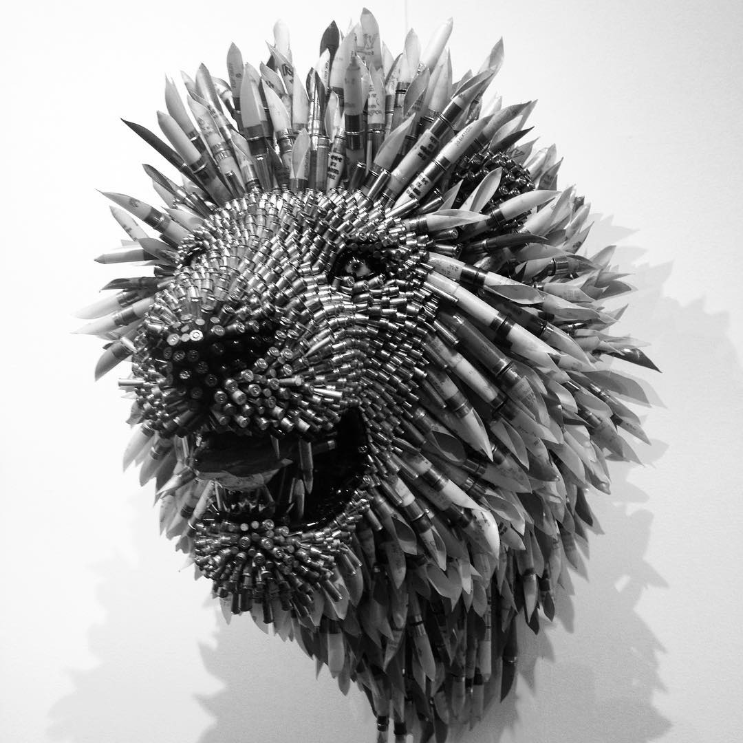 Lions head at @miamiproject by Federico Uribe made entirely of bullets and shotgun shells. #lionshead #lion #shotgunshells #bullets #artbasel #miamiproject #miamibeach #federicouribe #sculpture