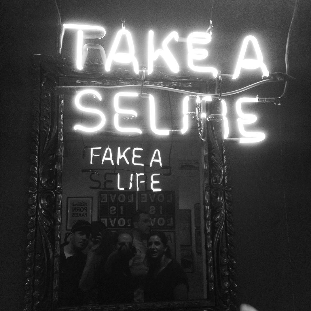 @matizsse double sided neon sign at @scopeartshow It was awesome watching people take selfies in front of this without looking at what the backside said in the mirror first. #selfie #neonsign #neon #mirror #fakealife #scopeartfair #scope #camilomatiz...