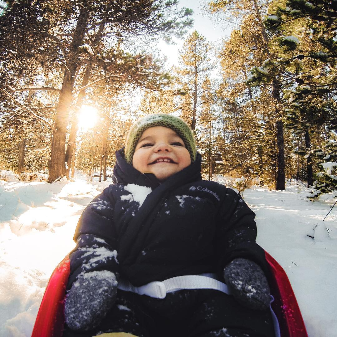 Photo of the Day! A first sled ride calls for a big smile. #
